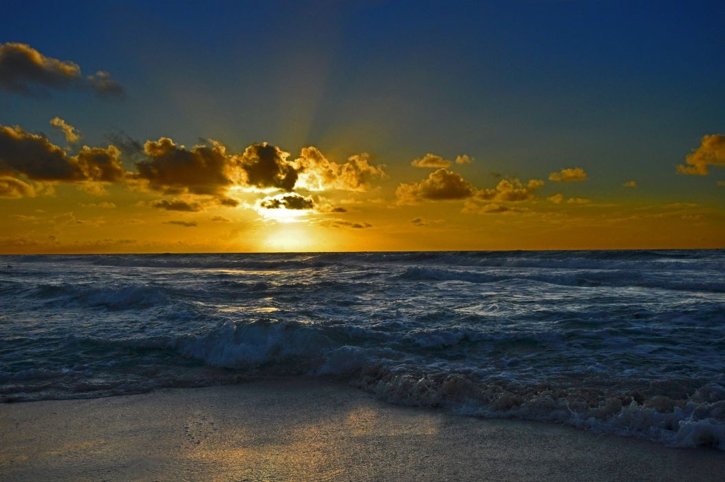 sky clouds sunset rays glow sea shore waves wallpaper