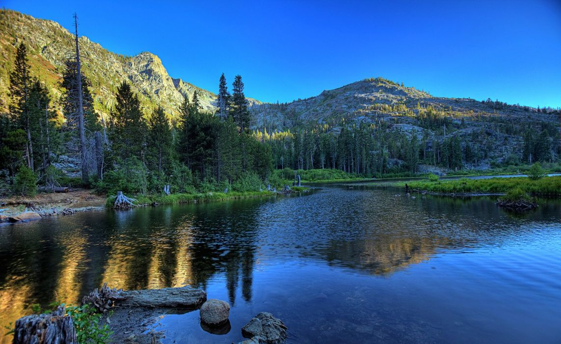 sky sunset mountains forest trees lake reflection stones wallpaper