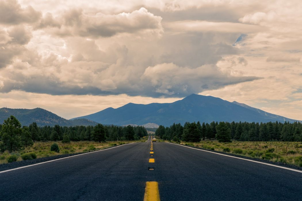 road car mountains clouds wallpaper