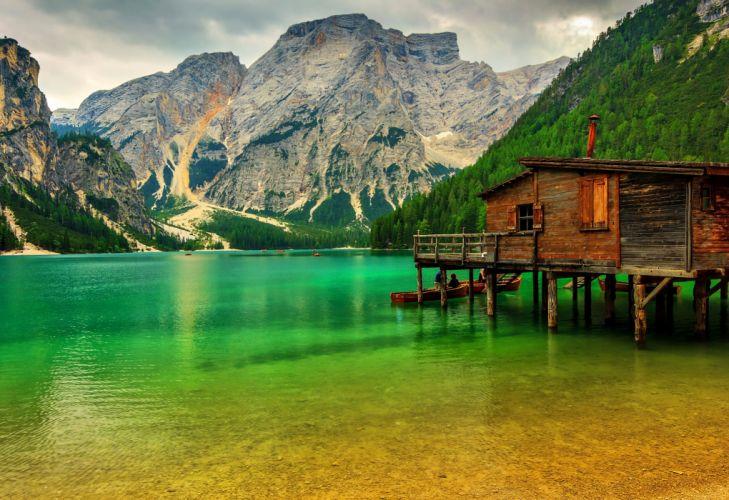 mountain lake Lake Sudtirol Italy boat pier rocks trees greenery wallpaper