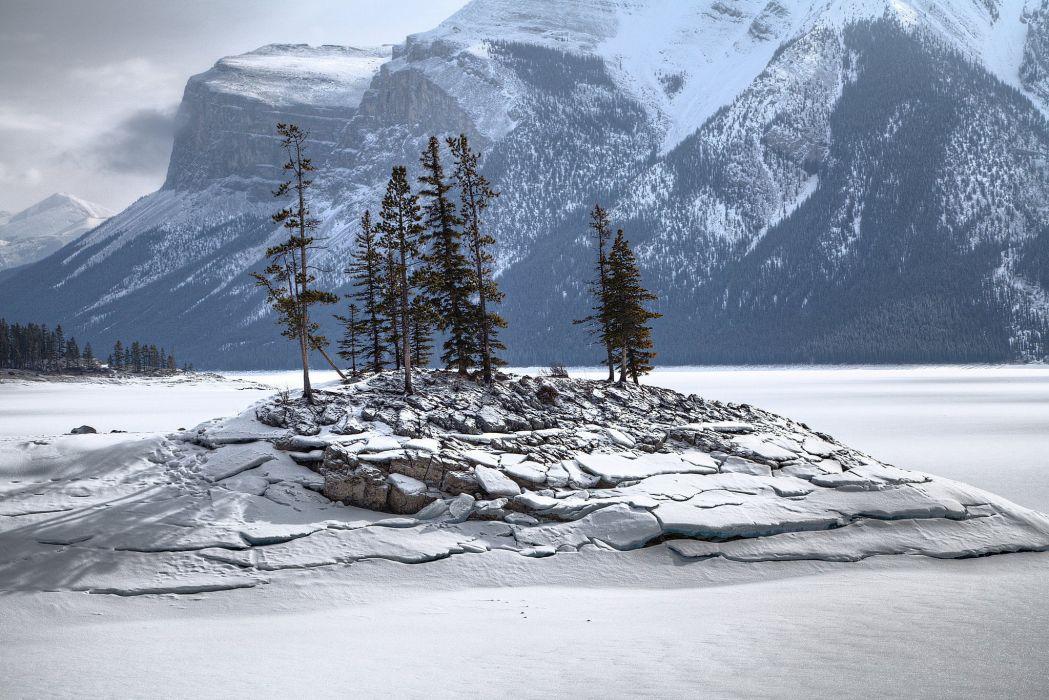 Mountains Lake Snow Winter Island Rock Trees wallpaper