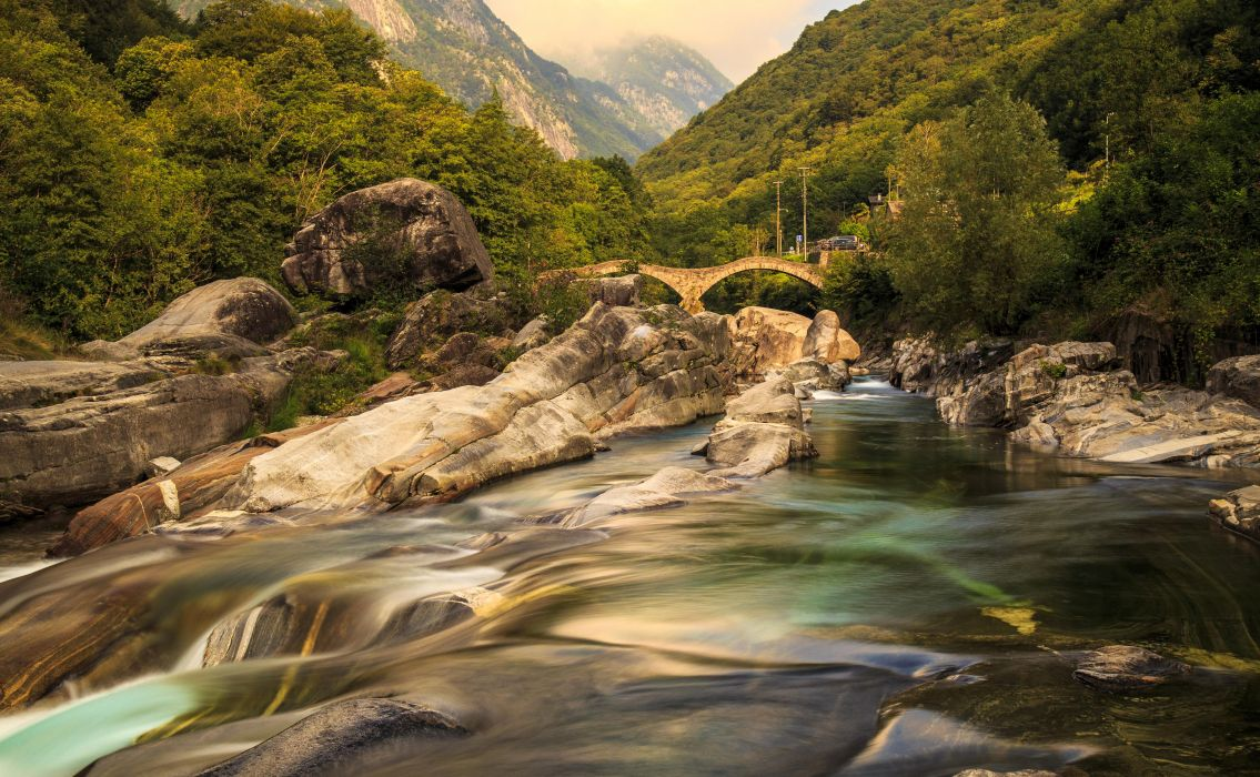 Switzerland Mountains Rivers Forests Bridges Stones Verzasca Valley Ticino Nature wallpaper