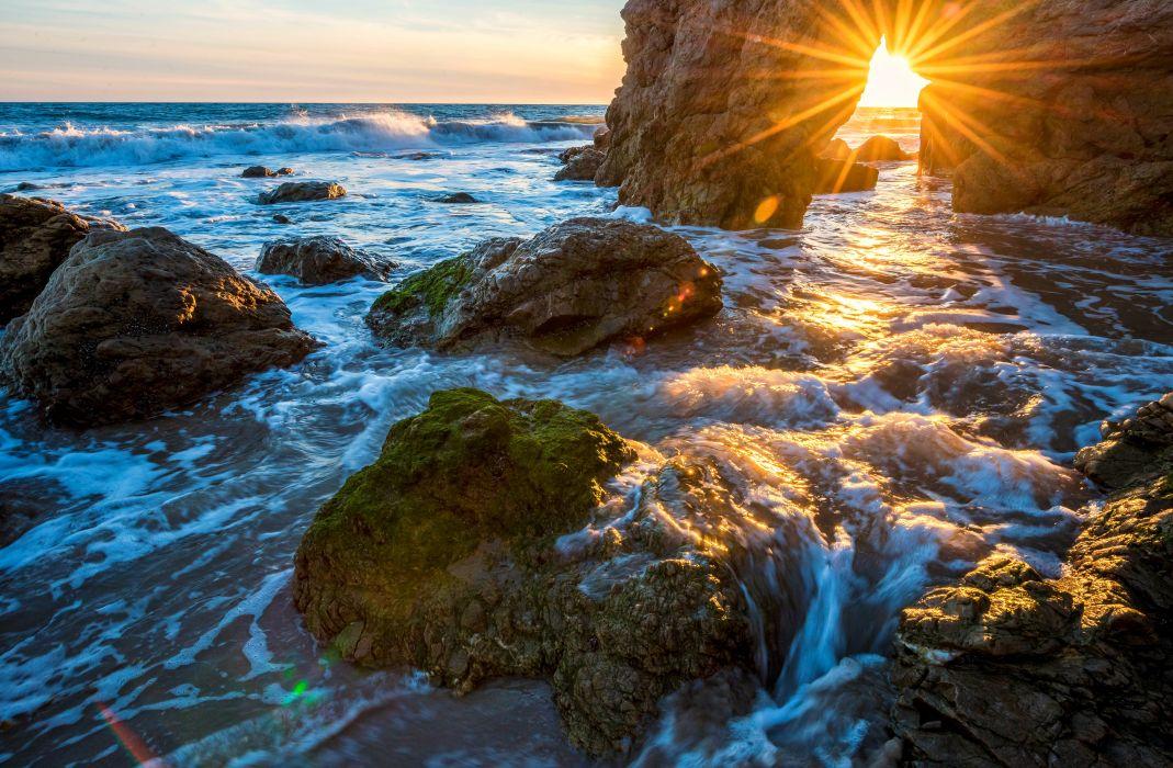 USA Sea Stones Waves Rays of light Moss Crag Malibu Nature wallpaper