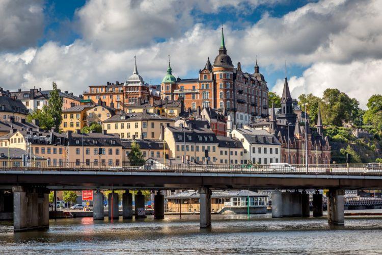 Stockholm Sweden Houses Rivers Bridges Clouds Cities wallpaper
