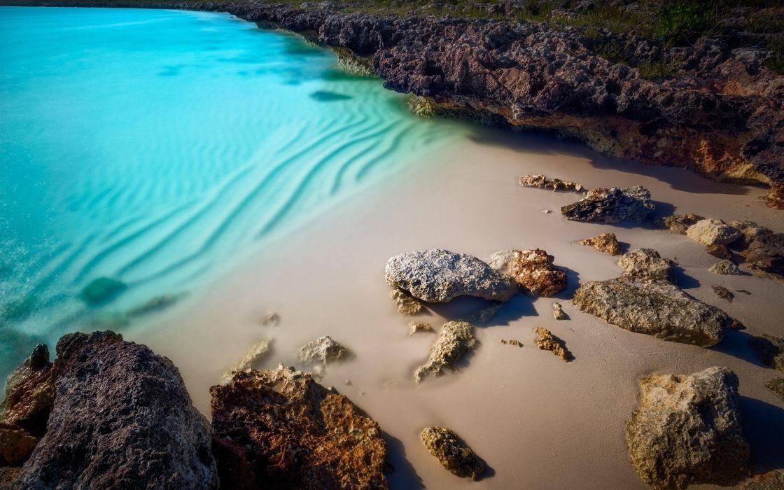 cala solitaria playa rocas mar wallpaper