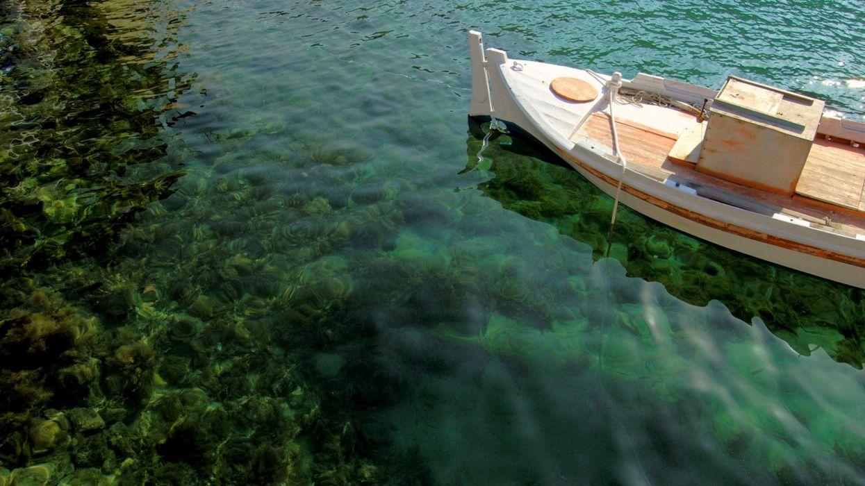 barco pesca orilla arrecife wallpaper