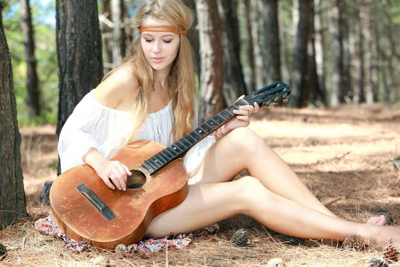 Cute Girl Playing Guitar