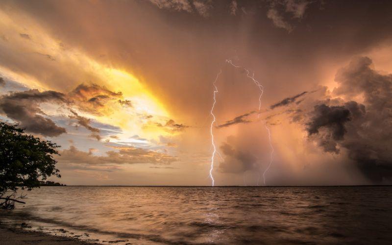 Clouds Storm Lightning Beach Ocean Nature wallpaper