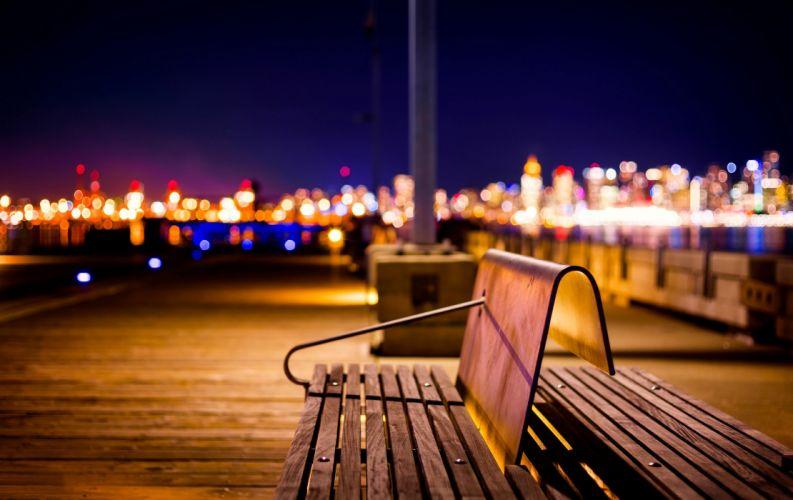 nature splendor night city city lights bench bokeh wallpaper