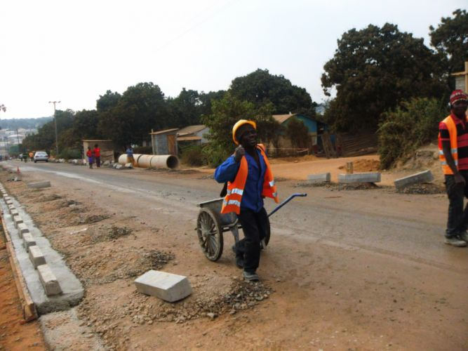 Road Constraction Man Wheelbarrow Chinese Contract Africa Zambia Compaund wallpaper