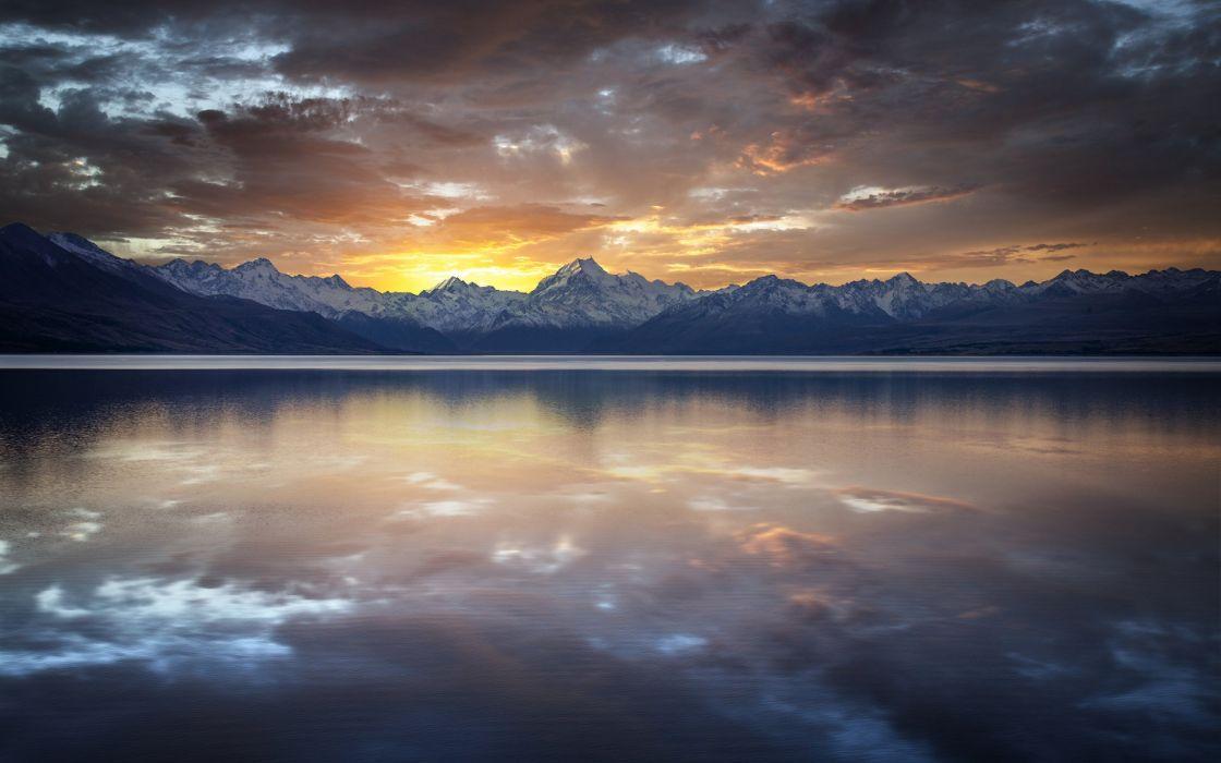 reflection sunset rocks clouds lake quiet range mountains wallpaper