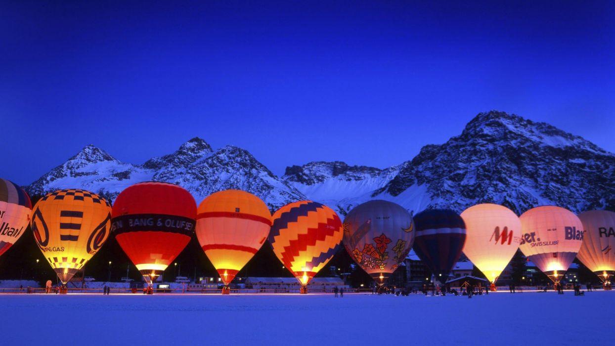 balloon hot air balloons evening landscape mountains snow lights nature wallpaper