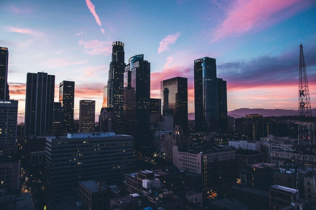 cityscape Los Angeles skyscraper silhouette mountains clouds sunset wallpaper