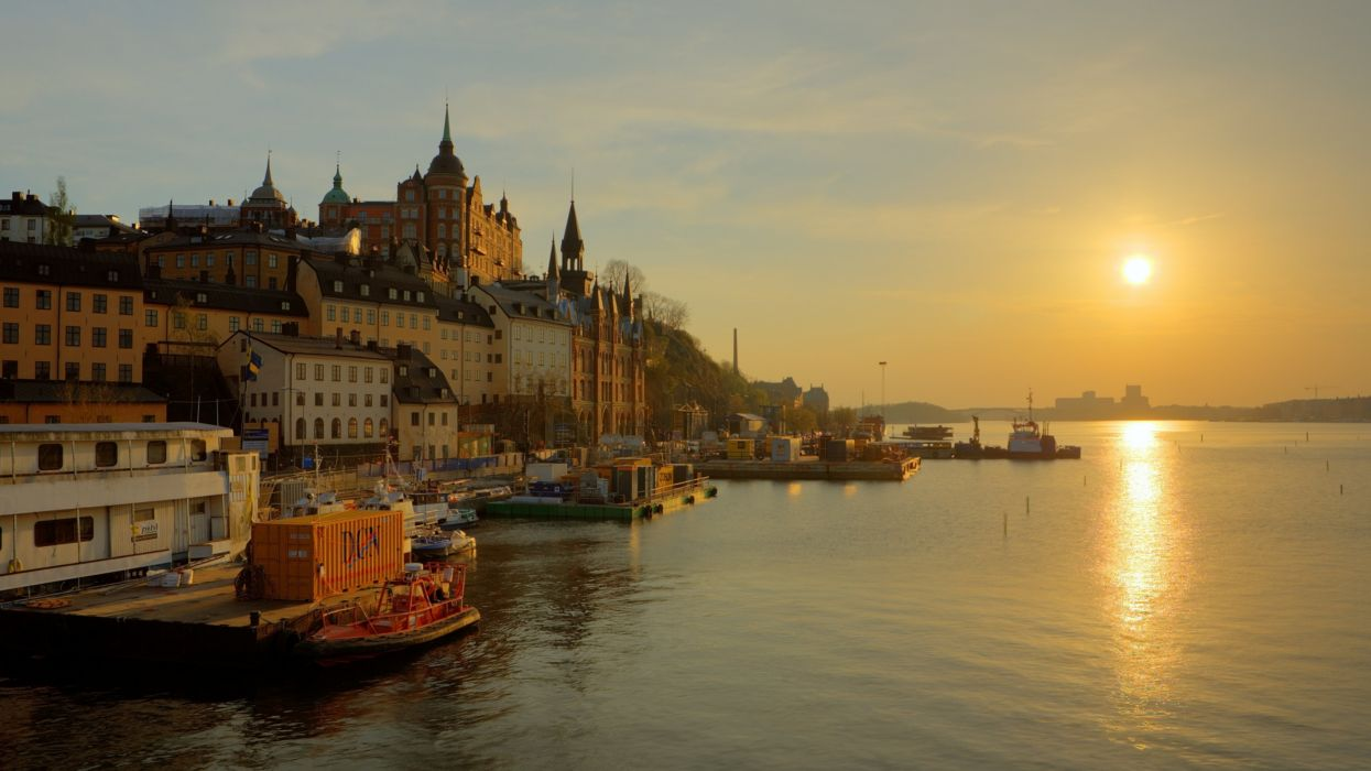 sweden stockholm promenade river sun sunrise fog gold houses towers water boat reflection sky  wallpaper