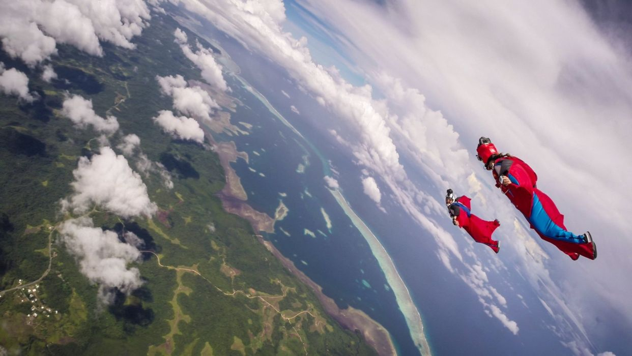 wingsuit drivers formation helmet camera clouds shadow sea island trailers parachute extreme sports wallpaper