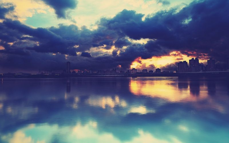 cityscape reflection water clouds overcast sunset wallpaper