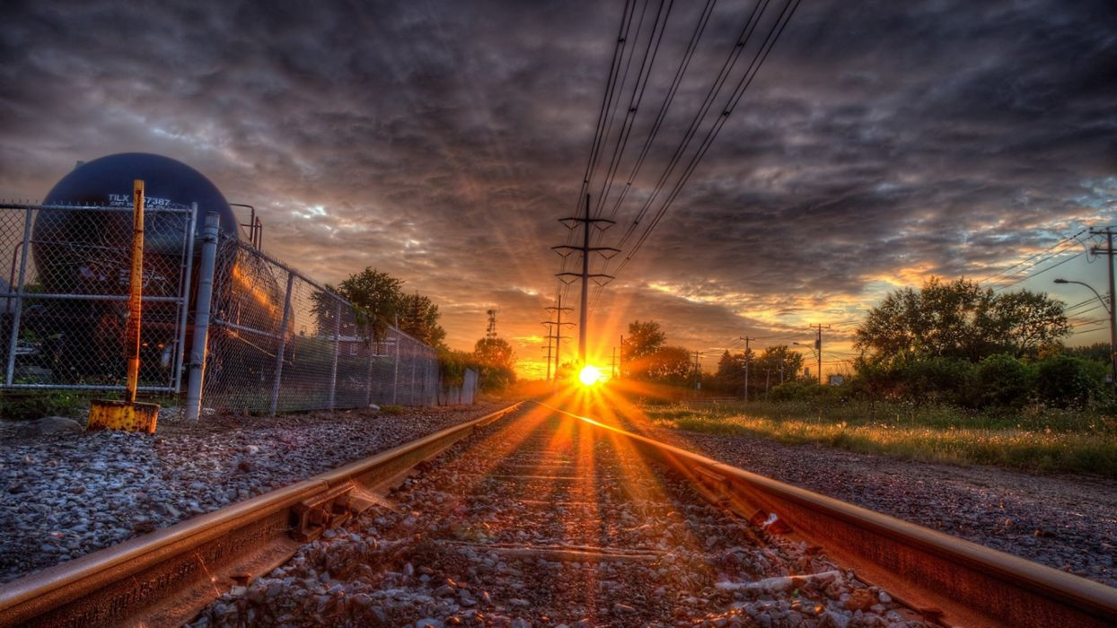 Sunset Over Train Tracks wallpaper