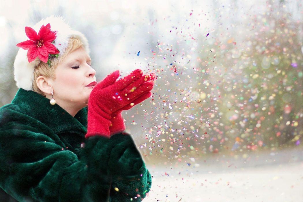 Young Woman Blowing Glitter Xmas Seasonal Winter wallpaper