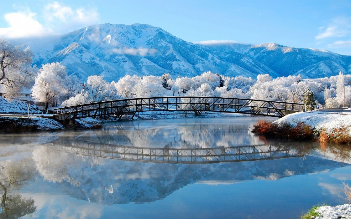 Winter landscape of the small river and mountains wallpaper