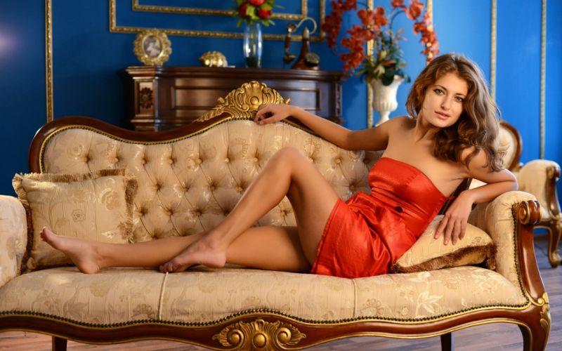 Jessica G Posing on a Sofa wallpaper
