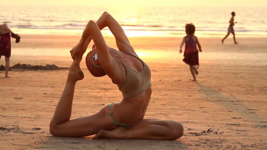 SENSUALITY girls-women-sexy-training-arambol-beach wallpaper