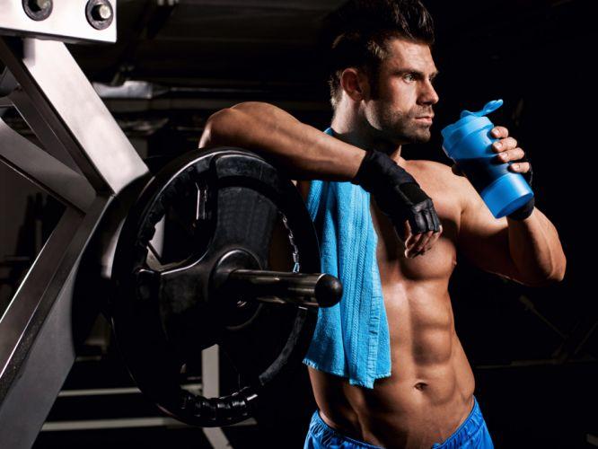Sports men-fitness-athletic-body-bodybuilding-workout-abdomen-squeeze wallpaper
