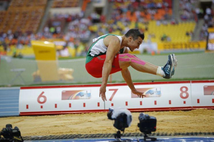 atleta salto longitud atletismo deportes wallpaper