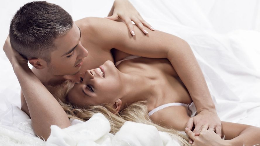 Bliss girl-woman-man-couple-laughing-bed-hug wallpaper