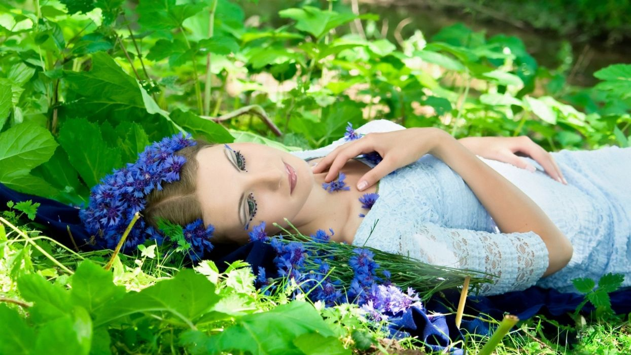 Photography woman-girl-sexy-blond-grass-leaves-flowers-violet-nature wallpaper