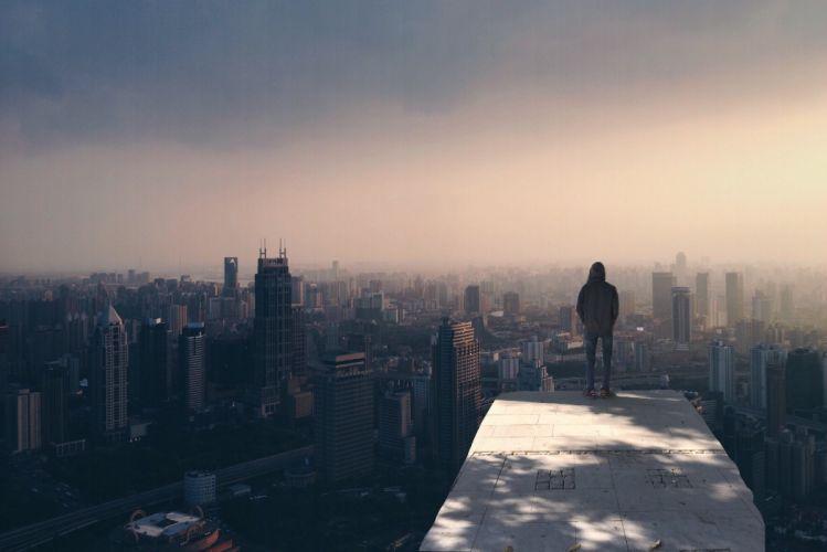 alone buildings city cityscape fog man person skyline smog standing wallpaper