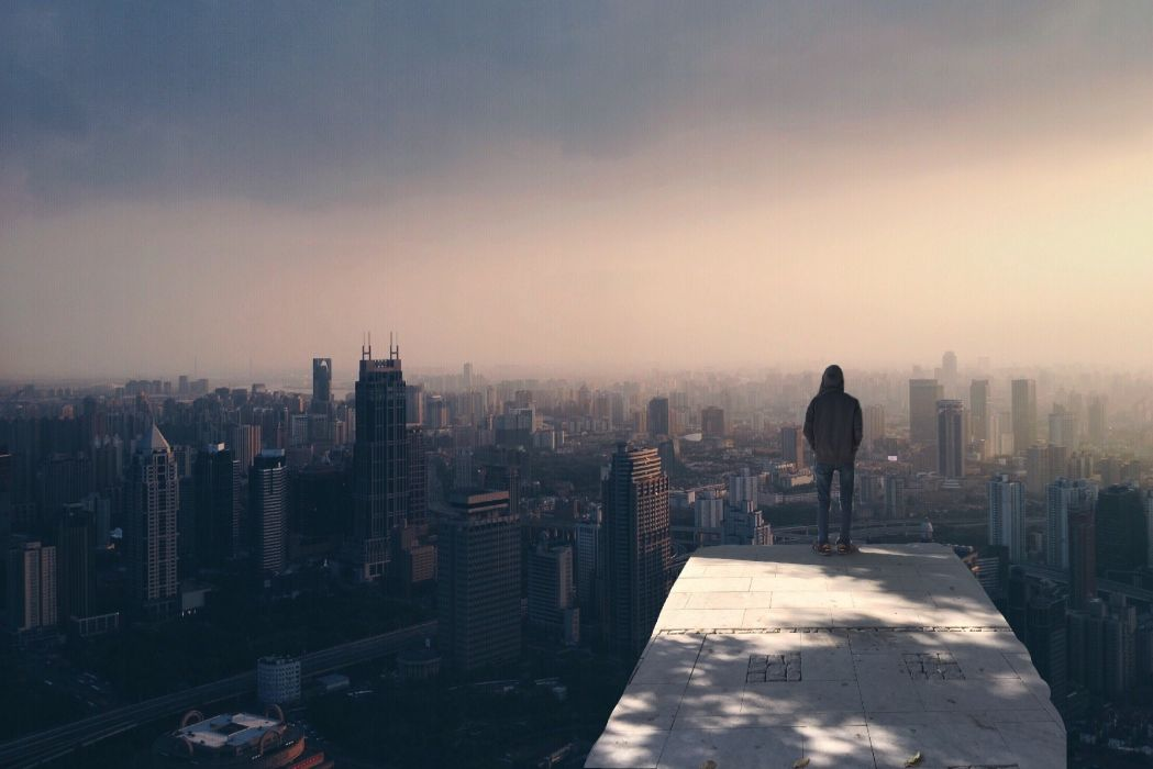 alone buildings city cityscape fog man person skyline smog standing wallpaper