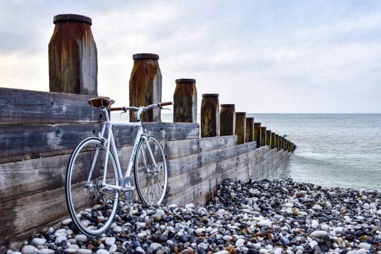 beach bicycle bike nature ocean sea seashore sky stones water wood wallpaper