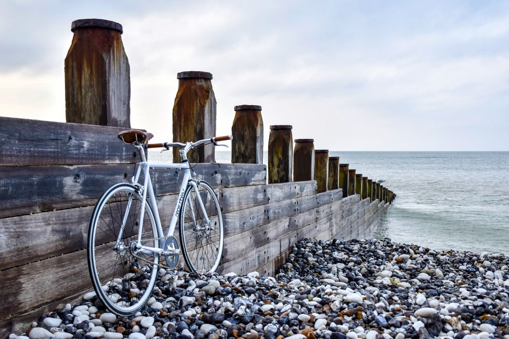 beach bicycle bike nature ocean sea seashore sky stones water wood wallpaper