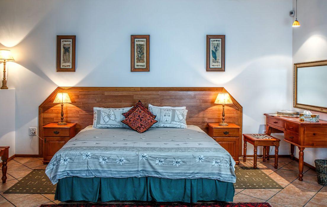 bed bedroom furniture headboard home indoors interior design lamps room table wallpaper
