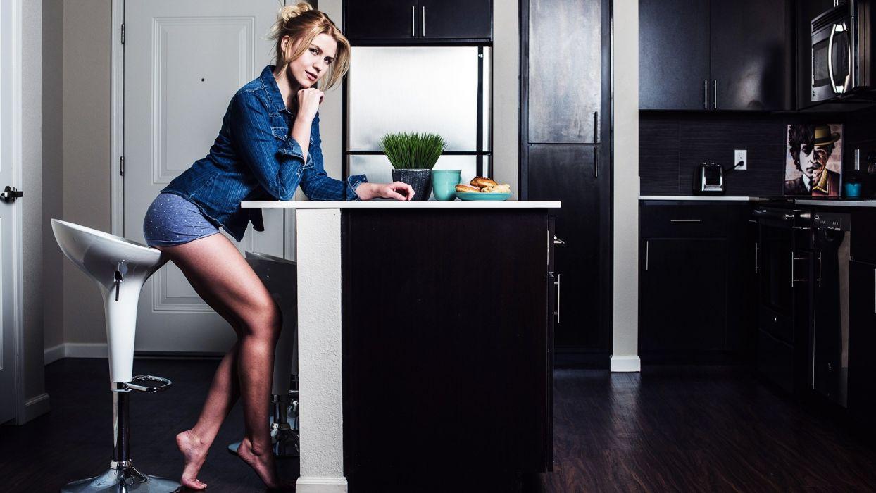 Sensuality woman-girl-sexy-sensual-blonde-looking-sitting-denim-short-barefoot-kitchen wallpaper