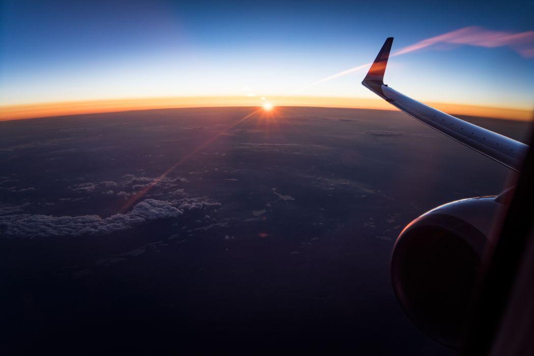above aeroplane aircraft engine airplane clouds flight plane sky sun sunset travel wallpaper