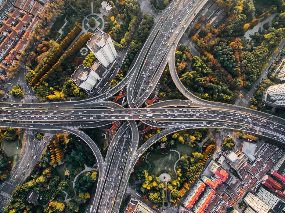 architecture bird's eye view buildings cars city cityscape highway infrastructure roads traffic trees urban wallpaper