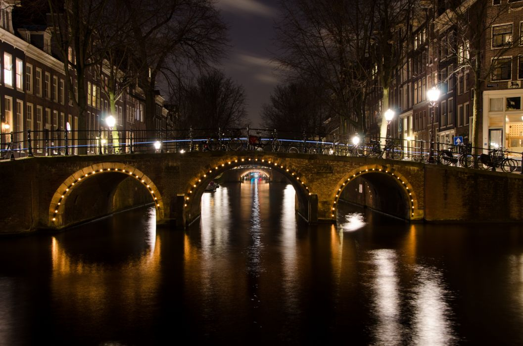 amsterdam bridge buildings canal city Holland lights netherlands night trees water wallpaper