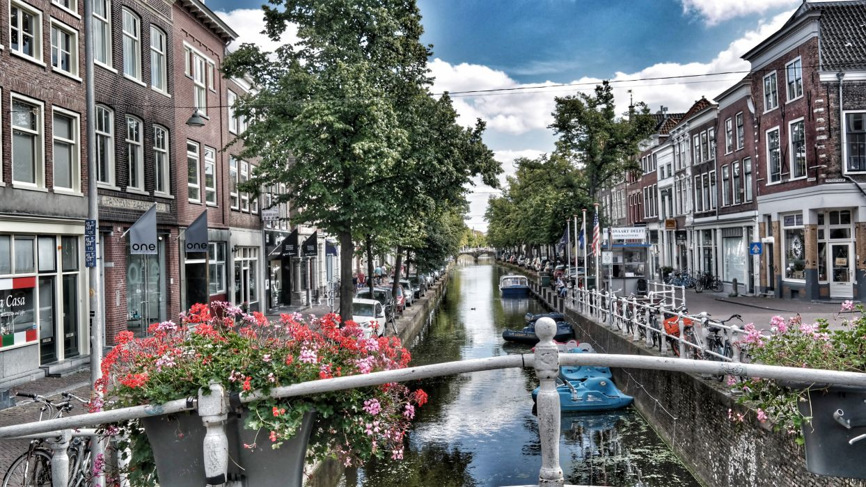 architecture bridge buildings canal city daylight exterior family home house outdoors sight street tourism town travel trees urban water wallpaper