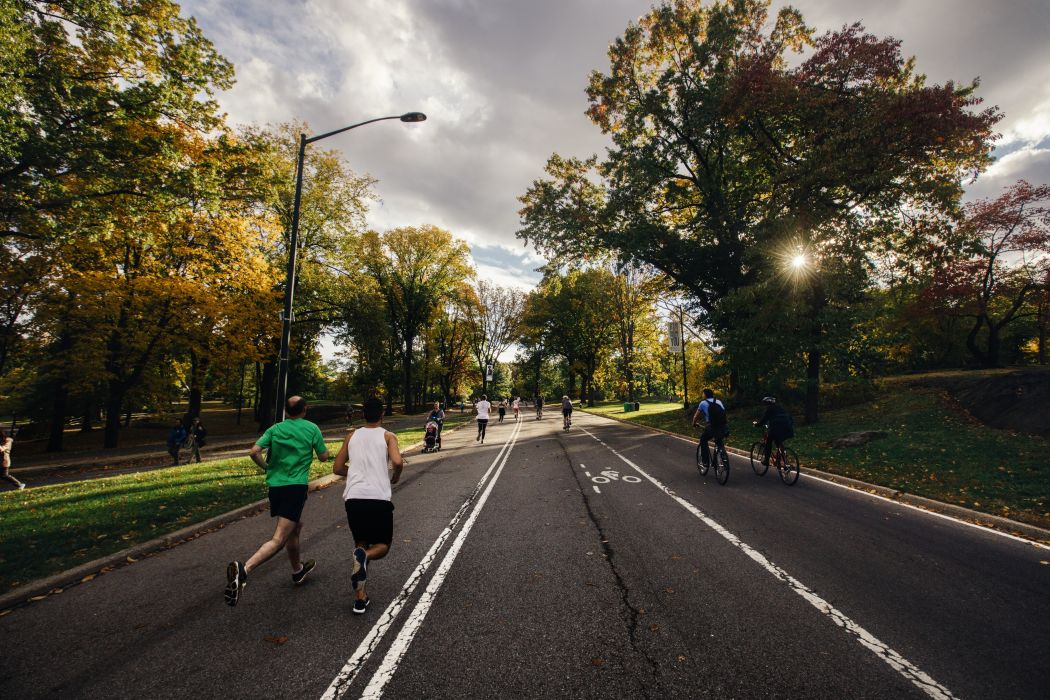 bicycles bike exercise health hobby jogging lamppost park people road run runners running trees wallpaper