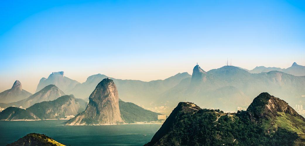 dawn fog foggy island landscape mist mountains nature outdoors rio de janeiro rocks scenic sea seashore sunset water wallpaper