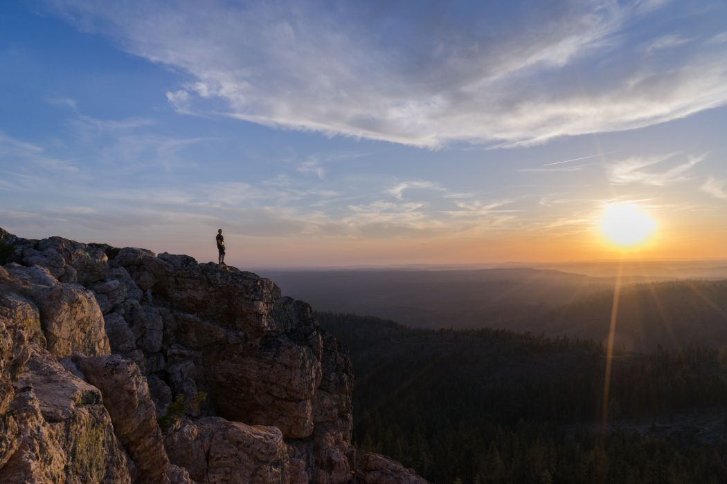 cliff clouds landscape man mountain nature person rocky mountain sky sun sunrise sunset trees wallpaper