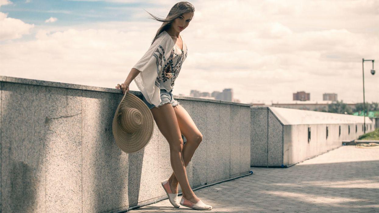 Sensuality woman-girl-sexy-sensual-denim-shorts-jeans-hat-summer-legs-wall wallpaper