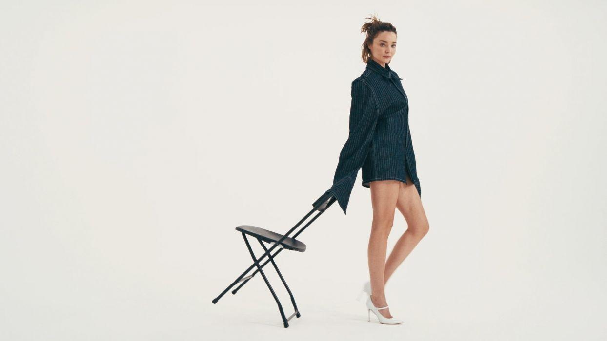 Sensuality woman-girl-sexy-sensual-jeans-denim-shirt-Miranda Kerr-model-legs-chair-posing wallpaper