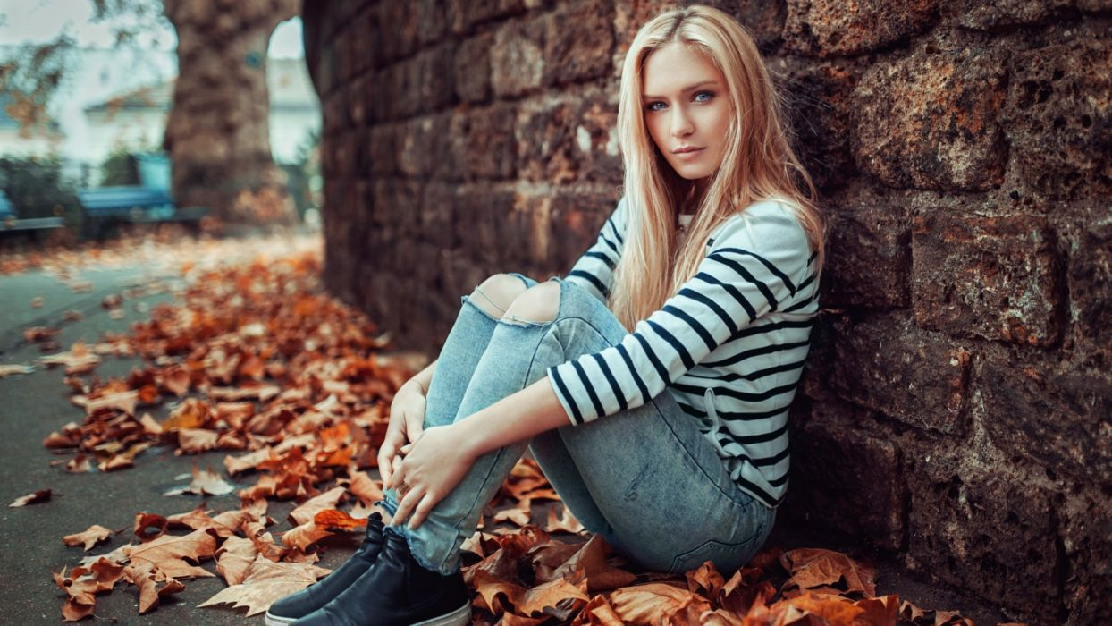 Sensuality woman-girl-sexy-sensual-jeans-denim-torn-pants-sitting-sneakers-leaf-autumn wallpaper