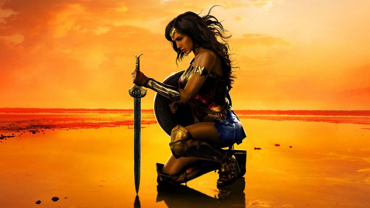 Movie Wonder Woman-2017-girl-Gal Gadot-sword-shield-warrior-kneelings wallpaper