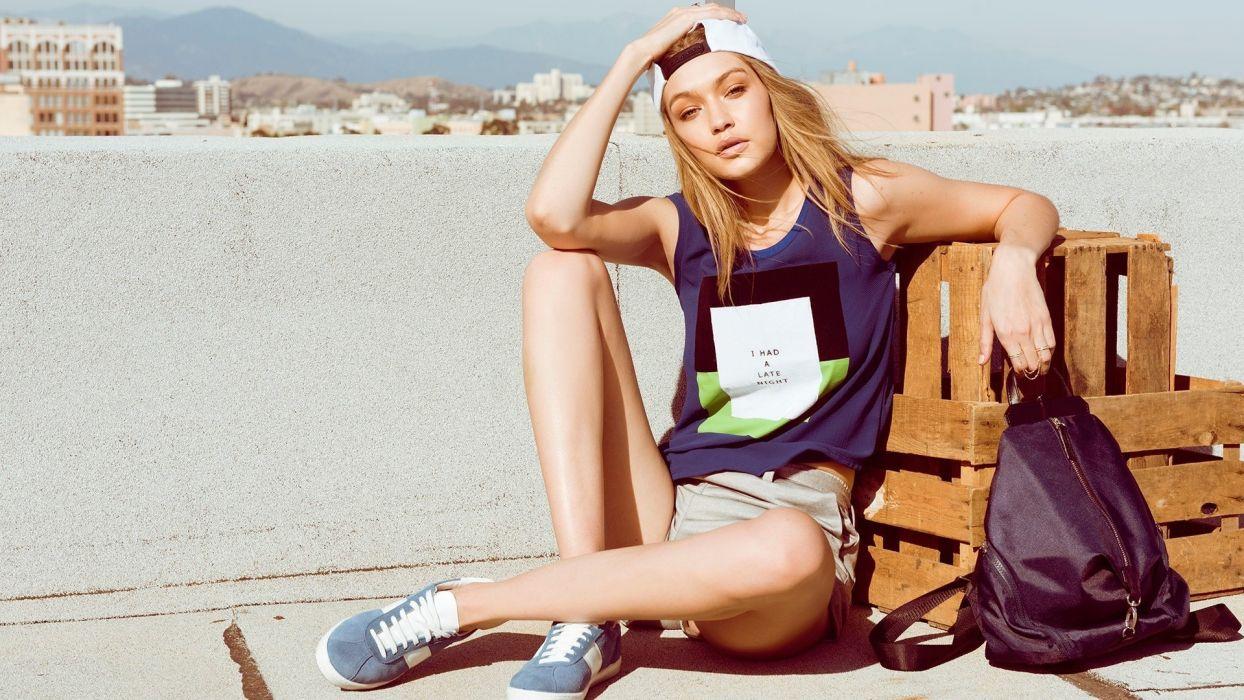 Sensuality sensual-sexy-woman-girl-Gigi Hadid-model-blonde-legs-sneakers-sitting wallpaper
