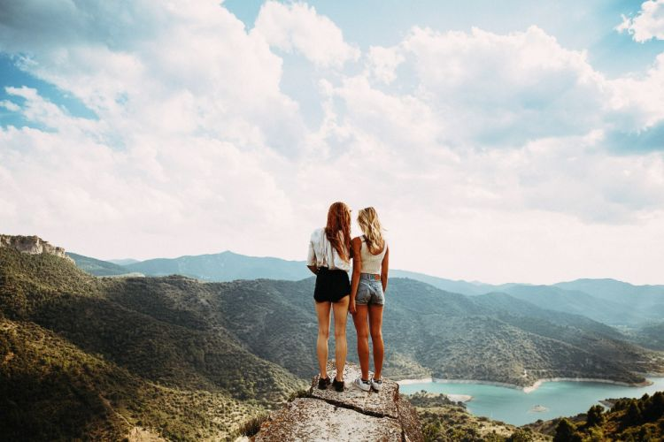 Photography-sensuality-sensual-sexy-woman-girl-couple-shorts-jeans-denim-legs-sneakers-windy-nature-cliff-sky wallpaper