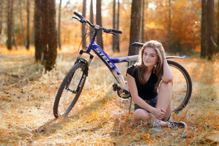 Sensuality-sensual-sexy-woman-girl-shorts-jeans-denim-bicycle-sitting-sneakers-trees-forest-smiling-blonde wallpaper