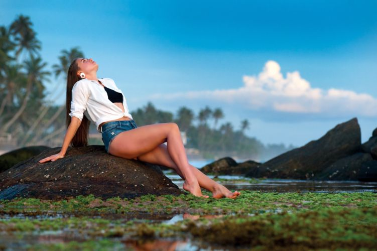 Sensuality-sensual-sexy-woman-girl-shorts-jeans-denim-legs-barefoot-water-rocks-clouds-nature-sky-model wallpaper
